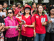 05 AUGUST 2016 - BANGKOK, THAILAND:       Supporters of Yingluck Shinawatra wait for her to arrive at the Supreme Court in Bangkok. Yingluck appeared in court of Thailand Friday to start her legal defense. She was deposed by a military coup in 2014 and is being tried on corruption and mismanagement charges related to a price support plan for Thai rice farmers that was instituted while she was Prime Minister. More than two years after her government was deposed by a military coup, she is still a popular figure and hundreds of her supporters packed the area around the courthouse to greet her when she arrived at the Court.     PHOTO BY JACK KURTZ