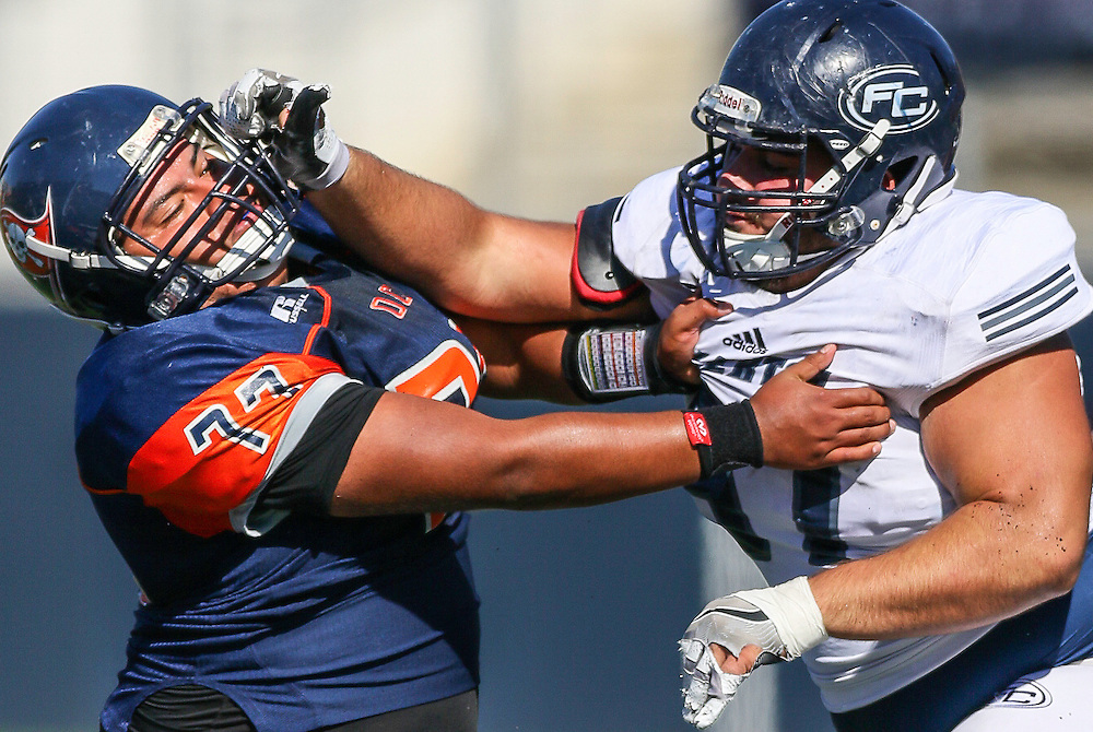 11/5/2016 - Orange Coast Pirate offensive lineman Marcus Horduno (77) defends an attack from Fullerton Hornet defensive lineman Domonic Sanchez (97) during the game at Orange Coast College - Costa Mesa, CA.<br /> <br /> &copy;2016 Jayme Spoolstra/Sports Shooter Academy