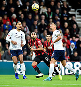Callum Wilson (13) of AFC Bournemouth wtches as Dejan Lovren (6) of Liverpool heads the ball during the Premier League match between Bournemouth and Liverpool at the Vitality Stadium, Bournemouth, England on 7 December 2019.