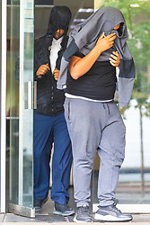 Mohammed Mussa, back, leaves Highbury Corner Magistrates Court on bail after rising drill music rapper UnknownT - real name Daniel Lena and  Ramani Boreland, were remanded in custody on charges of the murder of Steven Narvaez-Jara, 20, on New Year's Day last year, who together with Mussa who is charged with violent disorder and released on bail.