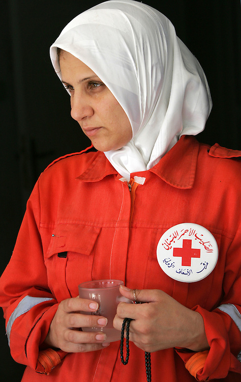 26th July 2006&. Tyre, South Lebanon. Lebanese Red Cross in Tyre on the 26th July 2006. Olivia, a volunteer from the Lebanese Red Cross, takes a break at her  base in Tyre, Southern Lebanon.Their vehicles have been attacked in recent days by Israeli aircraft whilst evacuating wounded civilians, two Red Cross workers were injured in the attack.