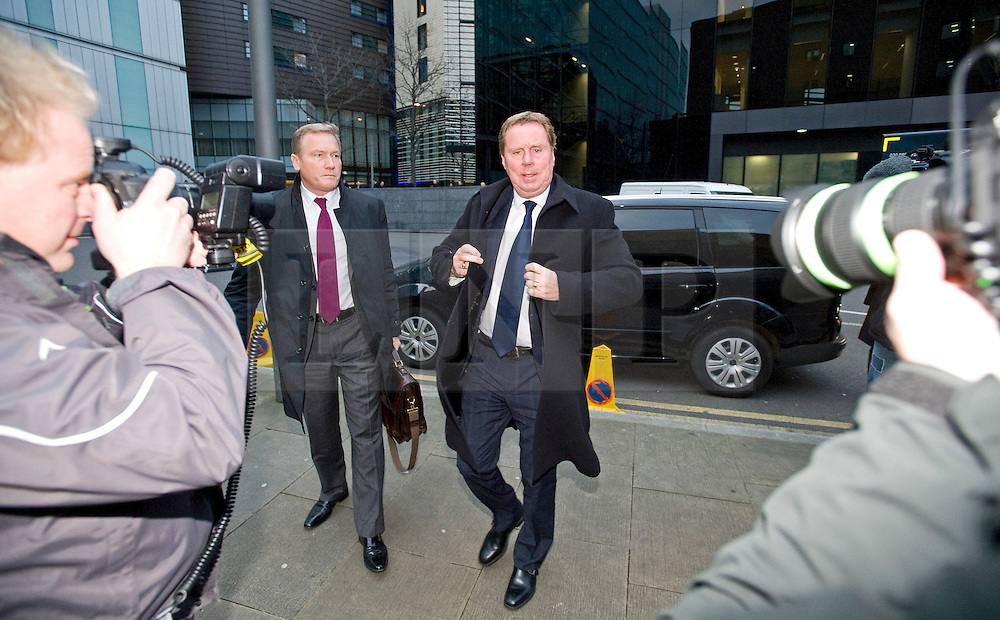 © Licensed to London News Pictures. 23/01/2012. London, UK.  Harry Redknapp (centre), Manager of Tottenham Hotspur FC arriving at Southwark Crown Court on January 23rd, 2012. Redknapp faces two counts of cheating the public revenue. Charges relate to the payment of $295k from Milan Mandaric to Harry Redknapp via a bank account in Monaco, evading tax and national insurance while the pair were at Portsmouth Football Club Photo credit : Ben Cawthra/LNP