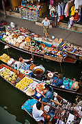 Vendors at Damnoen Saduak Floating Market in Ratchaburi, Thailand.