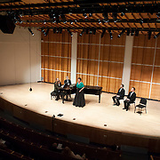"""May 22, 2012 - New York, NY : The Mirror Visions Ensemble's soprano Vira Slywotzky, standing, and pianist Margaret Kampmeier, foreground at far left, perform during a presentation of """"A Score of Scores: 20 Years of Mirror Visions"""" at Merkin Concert Hall in Manhattan on Tuesday evening. Also pictured are pianists Alan Darling, partially obscured at far left, (not performing) and Gary Chapman, third from left, (not performing), and from right, tenor Scott Murphree and baritone Jesse Blumberg (not performing).  CREDIT: Karsten Moran for The New York Times"""