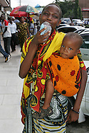 Woman and a baby in the streets of downtown Dar es Salaam, Tanzania.