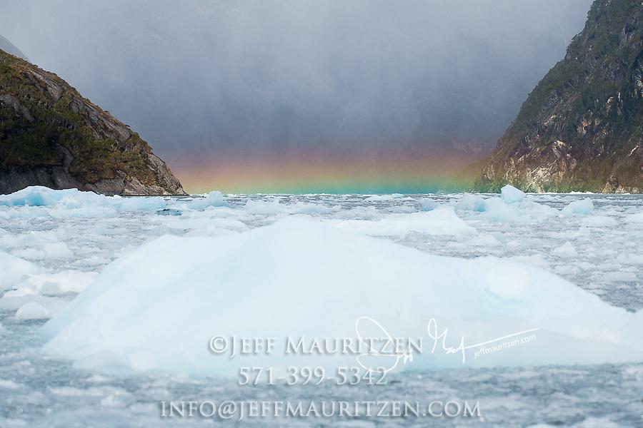 Rainbow over glacial ice in the Garibaldi fjord in Parque Nacional Alberto de Agostini, Chile.