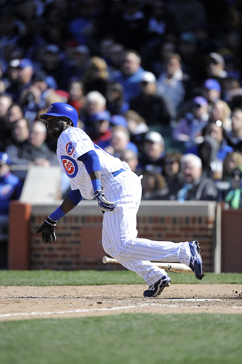 CHICAGO - APRIL 15:  Joey Gathwright #4 of the Chicago Cubs bats during the game against the Colorado Rockies on April 15, 2009 at Wrigley Field in Chicago, Illinois.  The Rockies defeated the Cubs 5-2.  (Photo by Ron Vesely)
