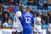 Oldham Athletic midfielder Ousmane Fane (24) and Gillingham defender Paul Konchesky (12) exchange words during the EFL Sky Bet League 1 match between Gillingham and Oldham Athletic at the MEMS Priestfield Stadium, Gillingham, England on 8 October 2016. Photo by Martin Cole.