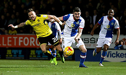 Darragh Lenihan of Blackburn Rovers and Michael Kightly of Burton Albion challenge for the ball - Mandatory by-line: Robbie Stephenson/JMP - 24/02/2017 - FOOTBALL - Pirelli Stadium - Burton upon Trent, England - Burton Albion v Blackburn Rovers - Sky Bet Championship