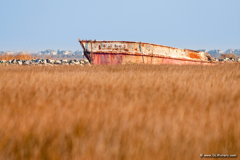 "An old fishing boat wreck named, ""Bald Eagle""in Wanchese North Carolina."