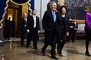 Senator Mitch McConnell of Kentucky and his wife, Elaine Chao, walk through the US Capitol Rotunda on their way to the inaugural luncheon, January 21, 2013 in Washington, DC.