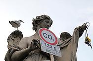 """Roma 5 Giugno 2008.  <br /> L' Associazione ambientalista  """"Terra""""  per protesta contro l'emissione di CO2, ha applicato  su 150 statue di Roma  mascherine antinquinamento e cartelli contro il CO2.<br /> Statua a Ponte Sant'Angelo<br /> Rome June 5, 2008.  <br /> L'Environmental association """"Earth"""" in protest against the emission of CO2, has applied to 150 statues of Rome anti-pollution masks and poster against the CO2."""