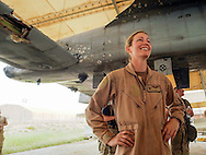 "Capt. ""KC"" from the 332nd Expeditionary Fighter Squadron, was able to fly her battle damaged A-10 Warthog safely back from a close air support mission over Baghdad with serious damage caused by anti- aircraft fire that hit the tail section,  cutting her  hydrolic controls. She landed at a forward air base in a country near Iraq. She is from the 23rd Fighter Group from Pope Air Force Base, North Carolina.(Alan Lessig/Air Force Times)SHE WOULD ONLY IDENTIFY HERSELF BY HER PILOT CALL SIGN."