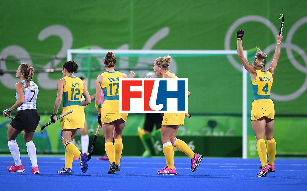 Australia's Madonna Blyth (2L), Georgina Morgan (C), Gabi Nance (2R), and Casey Sablowski (R) celebrate after their goalie stoped a penalty shot, as Argentina's Martina Cavallero looks on during the women's field hockey Australia vs Argentina match of the Rio 2016 Olympics Games at the Olympic Hockey Centre in Rio de Janeiro on August, 11 2016. / AFP / MANAN VATSYAYANA        (Photo credit should read MANAN VATSYAYANA/AFP/Getty Images)