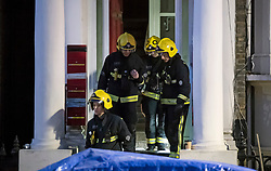 © Licensed to London News Pictures. 07/02/2018. London, UK. Fire crews at the scene of a large fire in Holland Park, West London in which one person has dies. Over 80 firefighters are battling the huge flat blaze on 'Millionaire's Row' in one of the wealthiest parts of the capital. Photo credit: Ben Cawthra/LNP