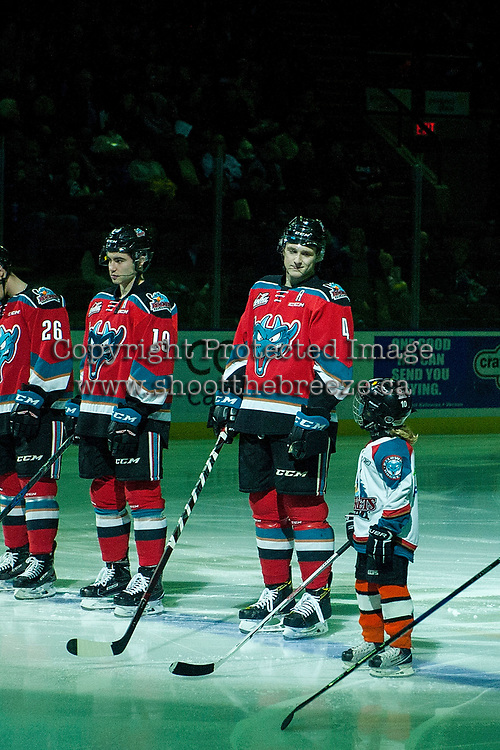 KELOWNA, CANADA - DECEMBER 2:  Gordie Ballhorn #4  of the Kelowna Rockets stands on the blue line with the Pepsi Player of the game during the national anthem against the Kootenay Ice on December 2, 2017 at Prospera Place in Kelowna, British Columbia, Canada.  (Photo by Marissa Baecker/Shoot the Breeze)  *** Local Caption ***