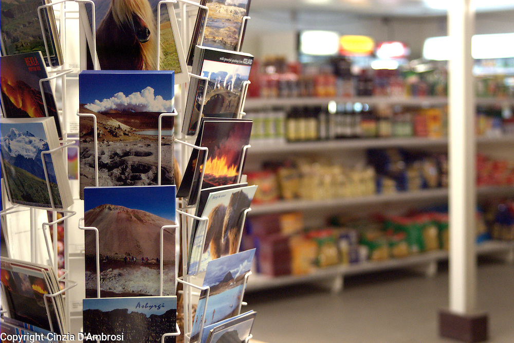 Postcards of a beautiful Iceland in the only supermarket on the highland camp where the workers of the Karahnjukar dam live.