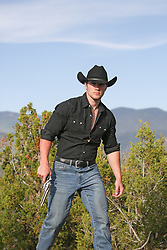 hot cowboy outdoors with a gun