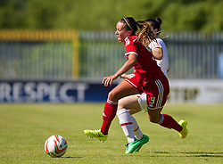 HAVERFORDWEST, WALES - Saturday, June 14, 2014: Wales' Natasha Harding is fouled by Turkey's Didem Karagnec who was sent off during the FIFA Women's World Cup Canada 2015 Qualifying Group 6 match at the Bridge Meadow Stadium. (Pic by David Rawcliffe/Propaganda)