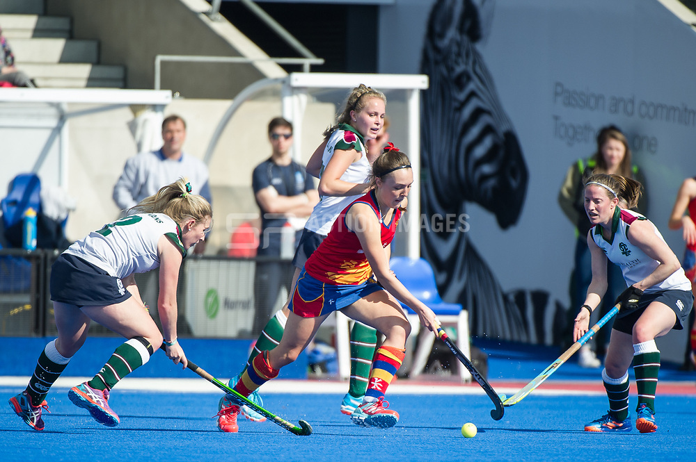 University of Birmingham's Olivia Paige is watched by Naomi Evans and Rebecca Middleton of Surbiton. University of Birmingham v Surbiton - Semi-Final - Investec Women's Hockey League Finals, Lee Valley Hockey & Tennis Centre, London, UK on 22 April 2017. Photo: Simon Parker