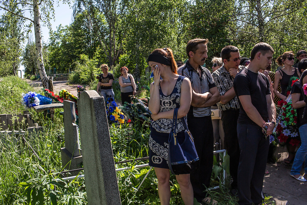 HORLIVKA, UKRAINE - MAY 24: Relatives grieve at the funeral of Aleksandr Politov, a pro-Russia militia fighter who was killed when his group attacked a Ukrainian military checkpoint two days earlier in the village of Blahodatne, on May 24, 2014 in Horlivka, Ukraine. Presidential elections are scheduled for tomorrow, but pro-Russia militias have been seeking to prevent them from being administered throughout the eastern part of the country. (Photo by Brendan Hoffman/Getty Images) *** Local Caption ***