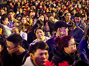 24 DECEMBER 2017 - HANOI, VIETNAM:  People on the plaza in front of St. Joseph's Cathedral in Hanoi wait for the Christmas Eve celebration to start. The commercial and gift giving aspect of Christmas is widely celebrated in Vietnam and Vietnam's 5+ million Catholics celebrate the religious aspects of Christmas.     PHOTO BY JACK KURTZ