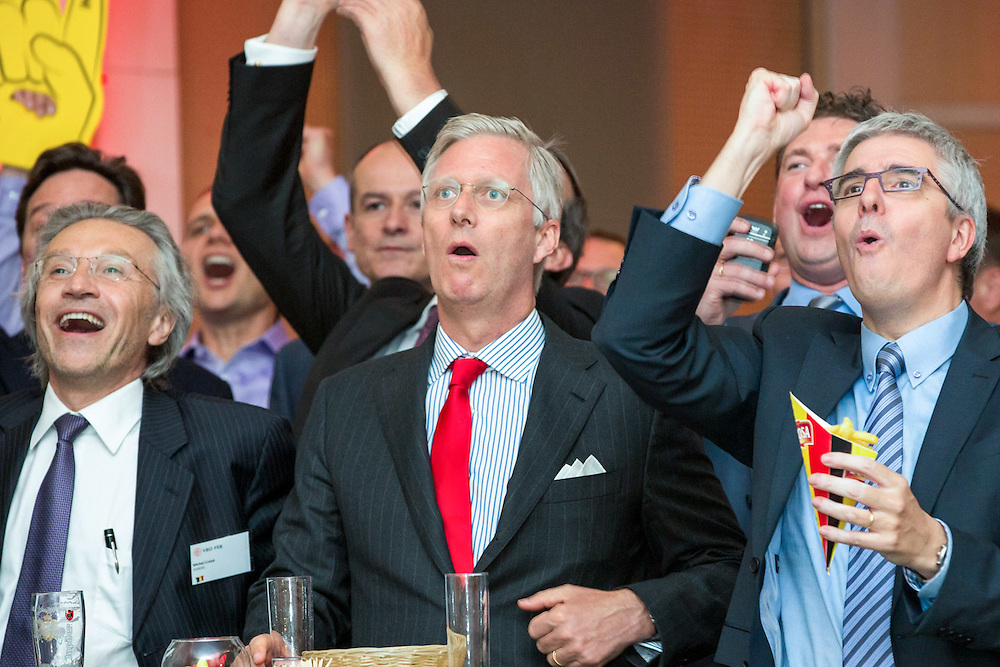 Brussels 17 June 2014<br />  <br />  King Philippe watches, on a large screen, the football match Belgium - Algeria along with representatives of Belgian companies that have contracts in the framework of the FIFA World Cup 2014 in Brazil, at the VBO - FEB (Federation of Enterprises in Belgium) headquarters<br />  <br />  Pix :   King Philippe , Peter Timmermans<br />  <br />  Credit Denis Closon / Isopix *** local caption *** 21697070