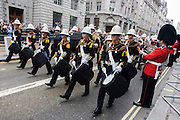 London 17/4/13 - Royal Marines bandsmen with black drums march before the funeral of Margaret Thatcher. Draped in the union flag and mounted on a gun carriage, the coffin of ex-British Prime Minister Baroness Margaret Thatcher's coffin travels along Fleet Street towards St Paul's Cathedral in London, England. Afforded a ceremonial funeral with military honours, not seen since the death of Winston Churchill in 1965, family and 2,000 VIP guests (incl Queen Elizabeth) await her cortege.