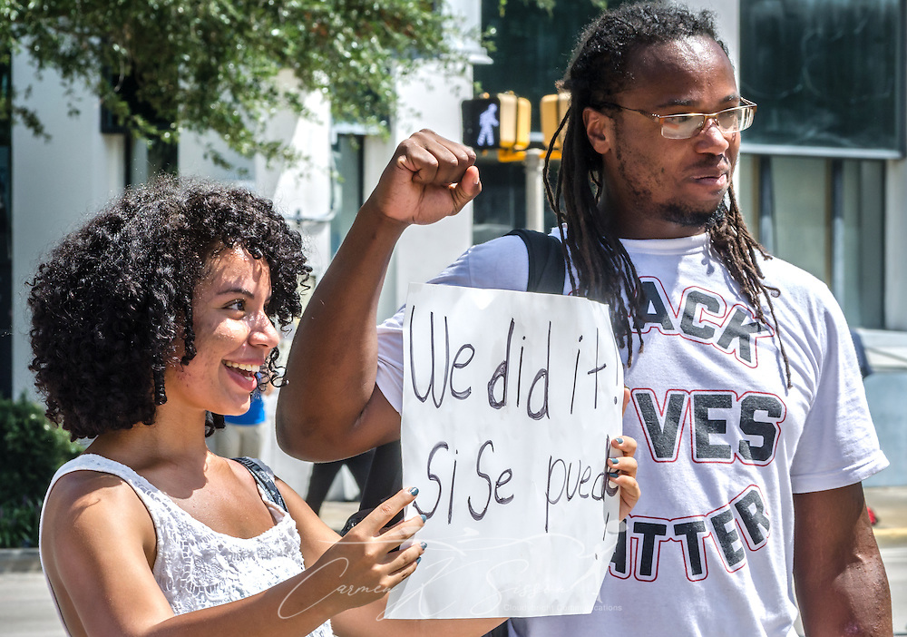 Confederate flag protestors pose for a photo outside the South Carolina State House, July 10, 2015, in Columbia, S.C. Thousands flocked to the South Carolina Statehouse to see the removal of the  Confederate flag. The flag flew above the capitol dome from 1961-2000, then was moved to the grounds. The flag, which is now permanently removed, will be stored at the Confederate Relic Room and Military Museum. The House voted for its removal after the shooting of nine African-Americans at Emanuel African Methodist Episcopal Church in Charleston, June 17, 2015. Alleged shooter Dylann Roof, who published a manifesto on his website supporting white supremacist beliefs, was seen in numerous photographs holding the Confederate flag. (Photo by Carmen K. Sisson/Cloudybright)