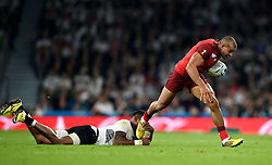 Jonathan Joseph of England takes on the Fiji defence - Mandatory byline: Patrick Khachfe/JMP - 07966 386802 - 18/09/2015 - RUGBY UNION - Twickenham Stadium - London, England - England v Fiji - Rugby World Cup 2015 Pool A.