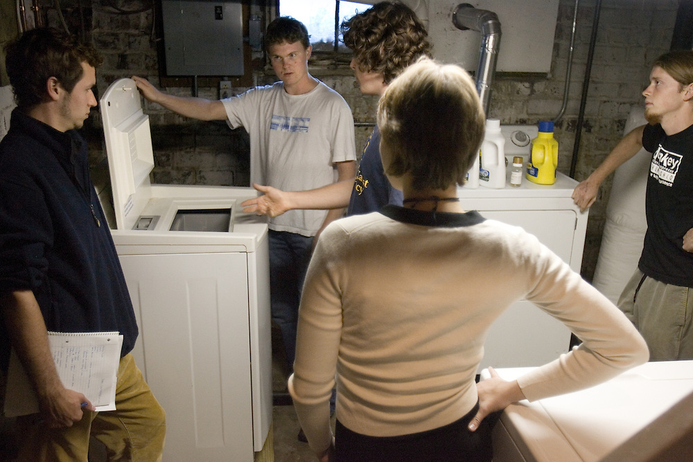 Thane Evans (from left), Jerone Anderson, Nathan Jud, Nora Rye and Danny Young look at the energy efficient washing machine in the basement of Ohio University's Ecohouse on Monday, 9/25/06.