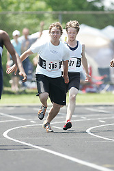 Hamilton, Ontario ---06/06/08--- Cory Gravel of Cochrane in Cochrane competes in the 4X100 meter relay at the 2008 OFSAA Track and Field meet in Hamilton, Ontario..SEAN BURGES