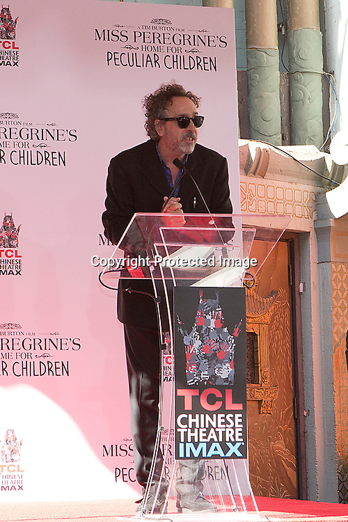 Directot, producer and writer Tim Burton speaking to the public during his imprints ceremony in the forecourt of the TLC Chinese Theatre in Hollywood