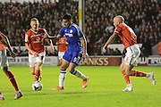 Radamel Falcao watched by James O'Connor during the Capital One Cup match between Walsall and Chelsea at the Banks's Stadium, Walsall, England on 23 September 2015. Photo by Alan Franklin.