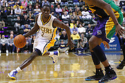 Feb. 21, 2012; Indianapolis, IN, USA; Indiana Pacers point guard Darren Collison (2) dribbles the ball around the back court against the New Orleans Hornets at Bankers Life Fieldhouse. Indiana defeated New Orleans 117-108. Mandatory credit: Michael Hickey-US PRESSWIRE