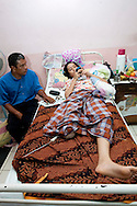 Padang, Western Sumatra, Indonesia, 7th October 2009:?A young girl with one leg amputatedas a result of the earthquakes lies in a ward of the  Dr M. Djamil hospital in Padang following the devastating earthquake in Western Sumatra that claimed the lives of an estimated 2000 people.?Photo: Joseph Feil