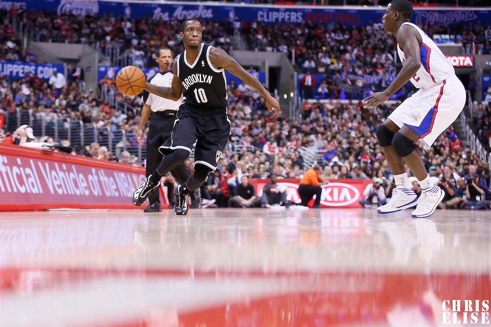 16 November 2013: Brooklyn Nets Tyshawn Taylor looks to pass the ball  during the Los Angeles Clippers 110-103 victory over the Brooklyn Nets at the Staples Center, Los Angeles, California, USA.