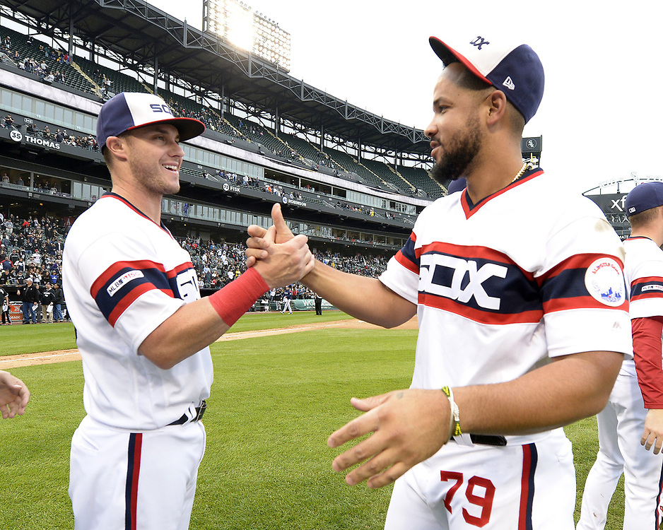CHICAGO - SEPTEMBER 29:  Jose Abreu #79 greets James McCann #33 of the Chicago White Sox after the game against the Detroit Tigers on September 29, 2019 at Guaranteed Rate Field in Chicago, Illinois.  (Photo by Ron Vesely)  Subject:   Jose Abreu; James McCann