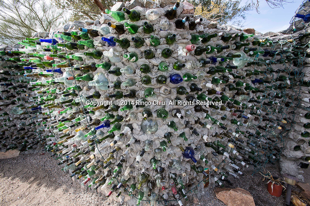 "An art work ""Bottle Wall"" is displayed at East Jesus, an experimental, habitable, extensible artwork gallery, on  January 4, 2014, in Slab City, California. Slab City or The Slabs is a snowbird campsite in the Colorado Desert in southeastern California, used by recreational vehicle owners and squatters from across North America. It takes its name from the concrete slabs that remain from the abandoned World War II Marine barracks of Camp Dunlap. (Photo by Ringo Chiu/PHOTOFORMULA.com)"