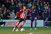 Ellis Chapman (12) during the EFL Sky Bet League 1 match between Lincoln City and Tranmere Rovers at Sincil Bank, Lincoln, United Kingdom on 14 December 2019.