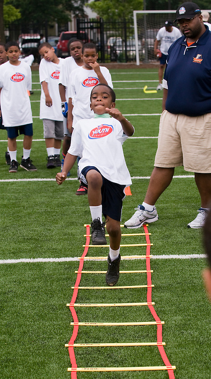 The NCAA Youth Football clinic hosted by the Military Bowl presented by Northrop Grumman was held June 11, 2011 at Deanwood Recreation Center in Washington, DC.  ( Alan Lessig/Alan Lessig Photography)........