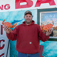 Jerry Crabtree holds up his catch of the day in Sturgeon Paul's in Warrenton/Hammond Oregon