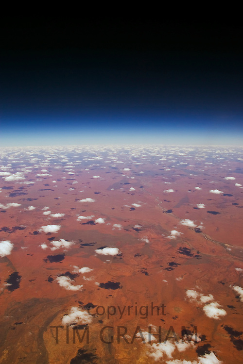 Red Centre viewed from aeroplane showing clouds and red earth over central Australia