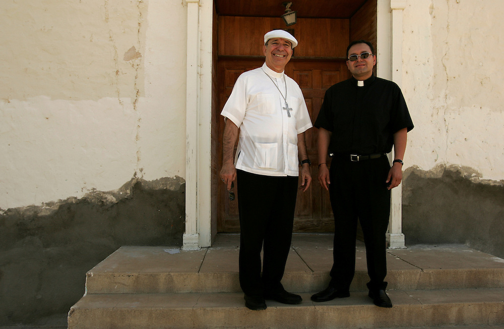 Bishop Ochoa and Father Fabian on the steps of the old church in Shafter, between Marfa and Presidio.