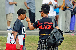 29 August 2015. Lower 9th Ward, New Orleans, Louisiana.<br /> Hurricane Katrina 10th anniversary memorial.<br /> People from the 'black lives matter' movement gather near where the levee wall breached a decade ago for a memorial to remember hurricane Katrina. <br /> Photo credit©; Charlie Varley/varleypix.com.