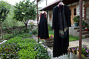 Traditional clothes hanging to air as they had been kept in storage in Vovousa village.