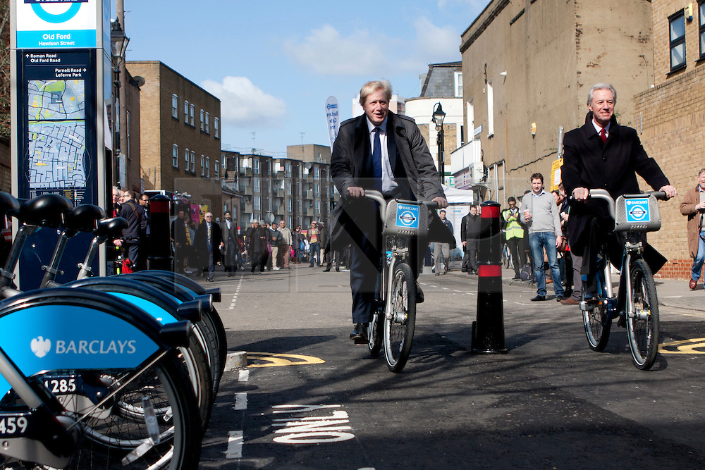 © Licensed to London News Pictures. 08/03/2012. London, UK. Mayor of London Boris Johnson (left) with Marcus Aigus (Right, Chairman of Barclays) pictured on Hewison Road in Bow today (08/03) to publicise the eastern extension of the Barclays Bike cycle hire scheme which launches today. Photo credit : James Gourley/LNP