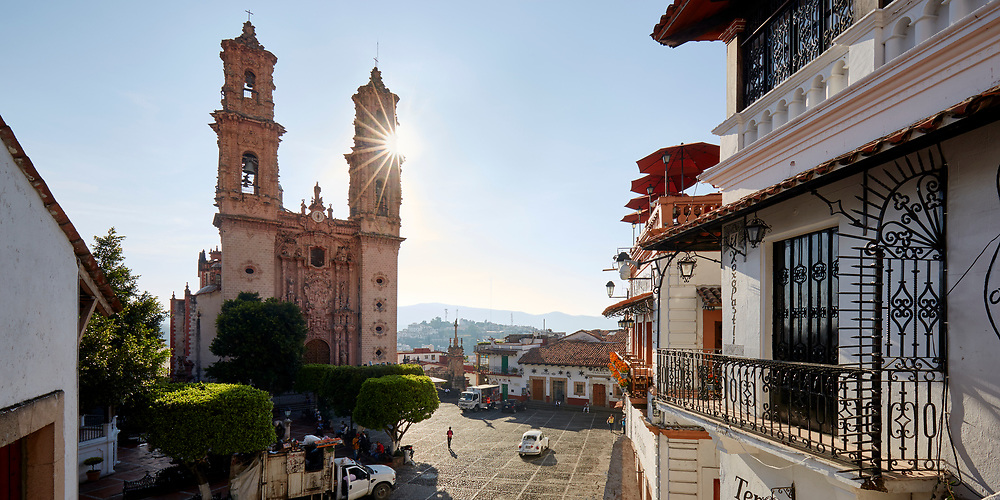 The sun rises behind the cathedral of Plaza Borda in Taxco, Guerrero, Mexico.
