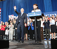 US Republican presidential nominee Senator John McCain (R-AZ)  waves to the crowd as his running mate Alaska Governor Sarah Palin speaks at a campaign rally in Cedar Rapids, Iowa, September 18, 2008.