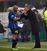 Maicon receives instructions from Inter Milan coach Jose Mourniho during the Serie A match between Inter Milan and AC Milan at Stadio Giuseppe Meazza on January 24, 2010 in Milan, Italy.